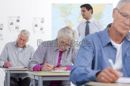 adult students taking test in college