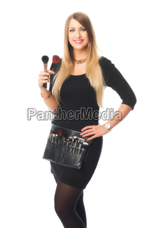 beautician with different make up brushes