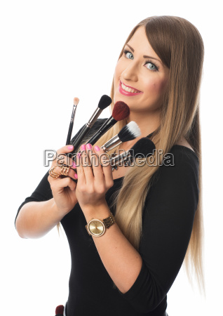 beautician with different brush sticks