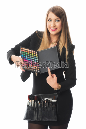 beautician with eyeshadow palette
