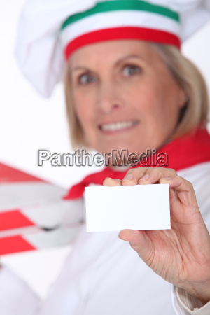 pizza chef displaying business card