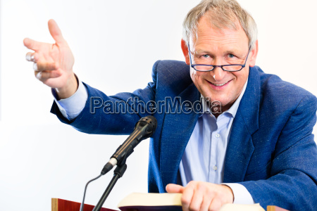 university professor gives lecture in the