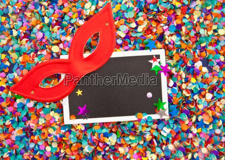 small blackboard on confetti