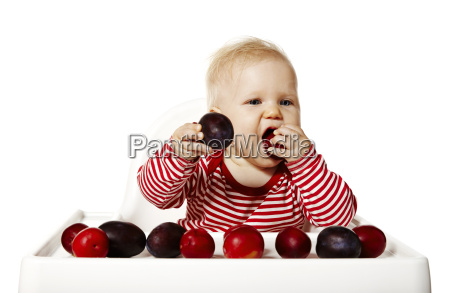 baby eating plums