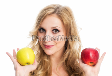 woman is holding apples