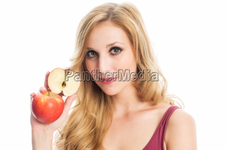 woman is holding an apple