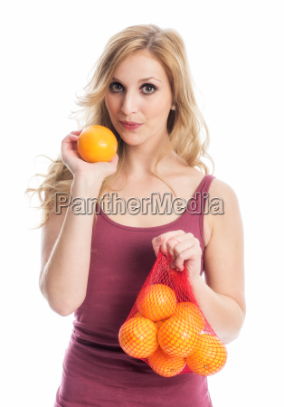 woman with oranges in the net