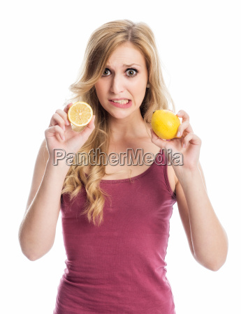 woman holding lemons