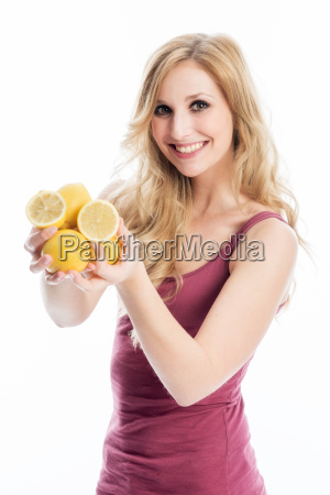 woman is holding lemons
