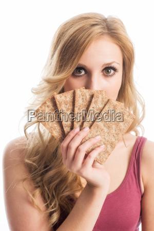 blond woman holding crispbread