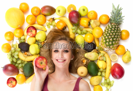 woman surrounded by fruit