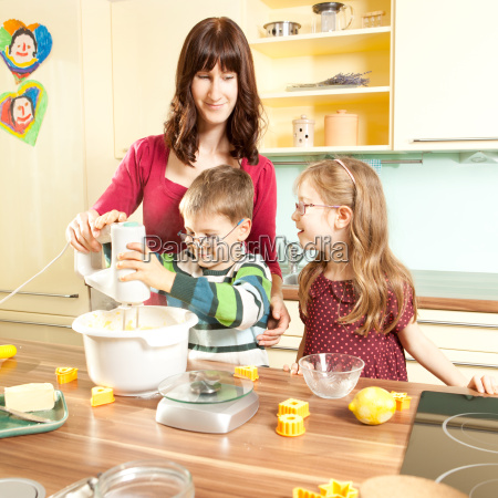 young parents bake in the kitchen