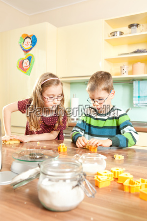 children baking in the kitchen while
