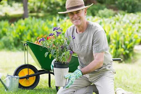 smiling mature man engaged in gardening
