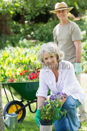 mature woman engaged in gardening with