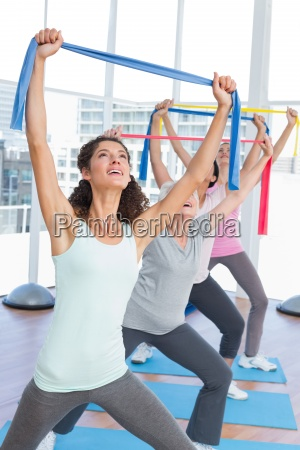 class holding up exercise belts at
