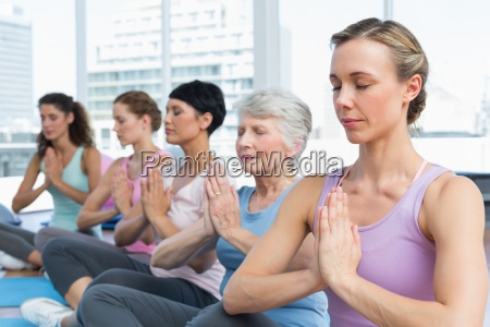 class sitting with joined hands in