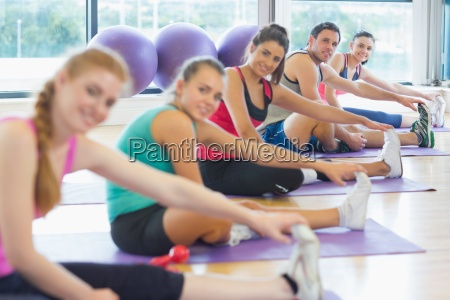 portrait of fitness class and instructor