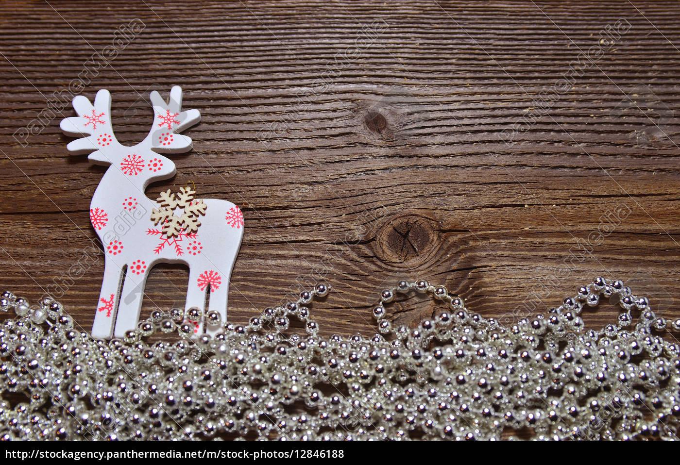 weihnachten holz hintergrund elch lizenzfreies foto. Black Bedroom Furniture Sets. Home Design Ideas