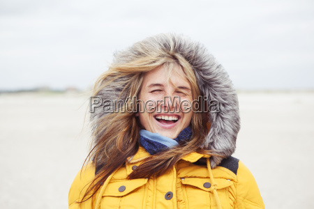 laughing woman with hat