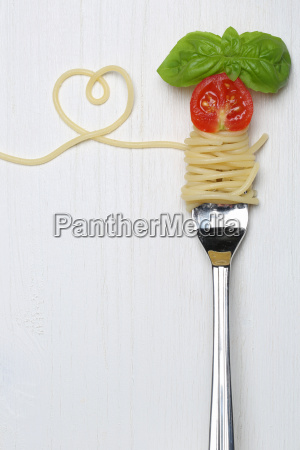 spaghetti pasta pasta dish with heart