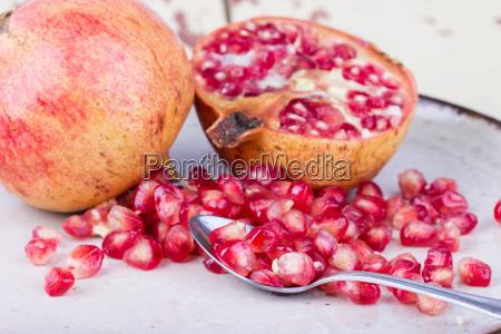 fruit pomegranate dish sliced pomegranate seeds