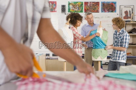 teacher talking to students in home