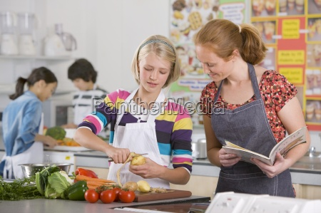 teacher helping student with recipe in