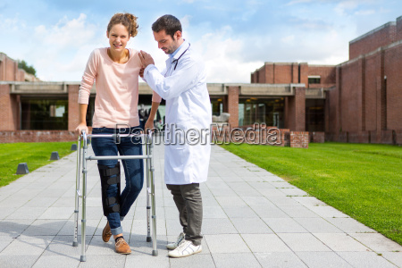young doctor assisting a young woman