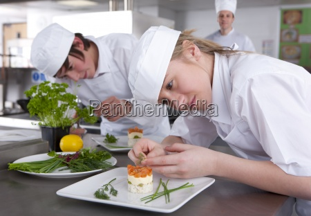trainee chefs working together in commercial