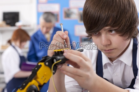 student working on robotic device in