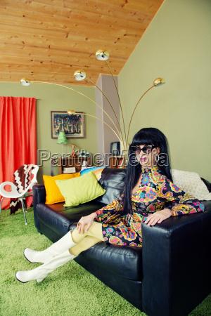 calm lady sitting on sofa