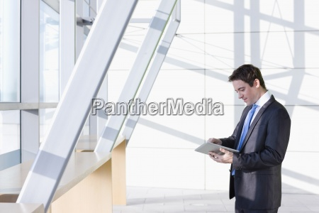 businessman using digital tablet in modern