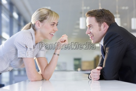 happy businessman and businesswoman talking face