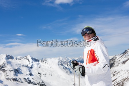 smiling man wearing ski goggles and