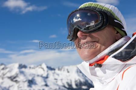 close up of smiling man wearing