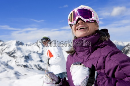 close up of smiling woman wearing