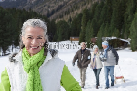 portrait of smiling woman in snowy
