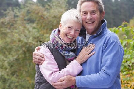 portrait of smiling senior couple hugging