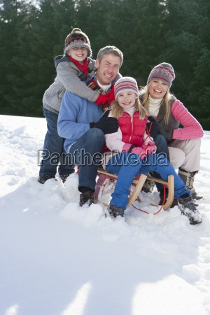 portrait of smiling family sitting on