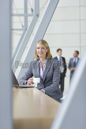 portrait of smiling businesswoman in suit