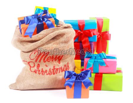 bunte weihnachts hintergruende mit santas geschenksack