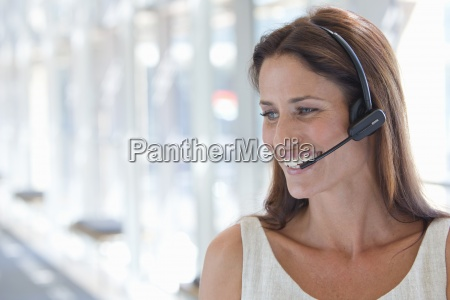 close up of smiling businesswoman wearing