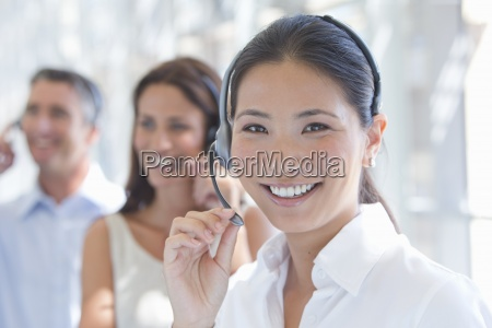 close up portrait of smiling businesswoman