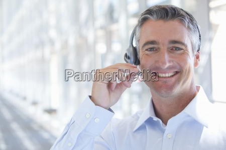close up portrait of smiling businessman