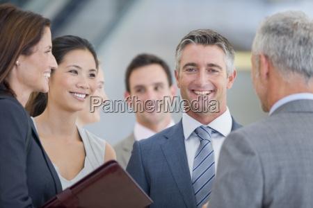portrait of smiling businessman among co