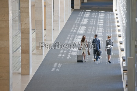 business people walking in lobby of