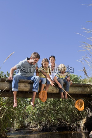 family with fishing nets sitting on