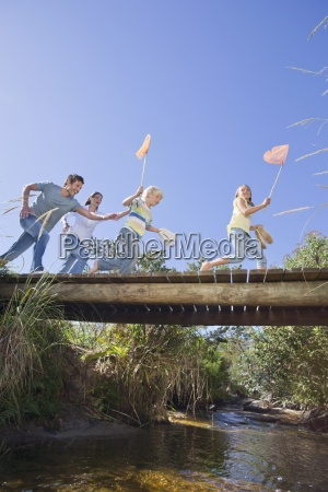 happy family with fishing nets running