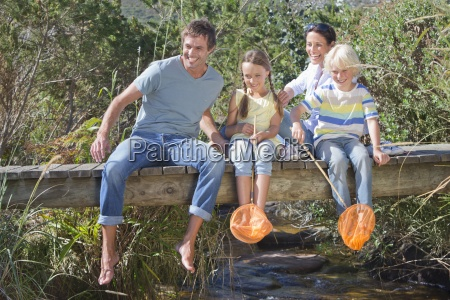 happy family with fishing nets sitting